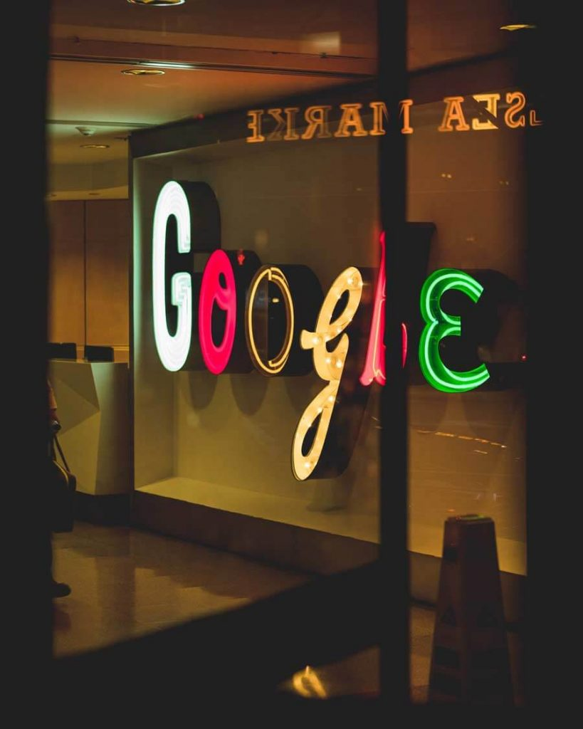 google in neon light on the wall